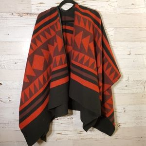 Adorable red/back sweater poncho